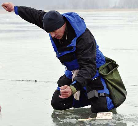 Ochotka na lodzie
